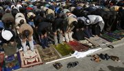 Iraqi men attend Friday prayers in the Shiite enclave of Sadr city in Baghdad, Iraq.
