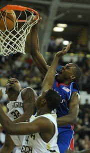Kansas' Mario Chalmers elevates over Georgia Tech' Jeremis Smith (34) and Alade Aminu for a  rebound and dunk on Tuesday in Atlanta, Ga.