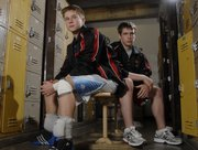 Lawrence High Wrestlers Blake Greenfield, left, and Brian Cain are only juniors, but they are leaders of the team.