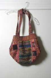 A purse made of recycled silks from Nepal.
