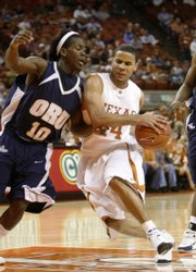 Texas guard D.J. Augustin drives to the basket. Augustin scored 24 points in the Longhorns' 66-56 victory over ORU on Tuesday in Austin, Texas.
