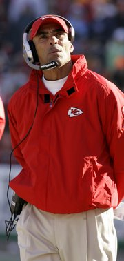 Kansas City coach Herm Edwards looks to the scoreboard during Sunday's loss to Tennessee. The Chiefs will finish the year with a 2-6 record at home, their worst since 1977.