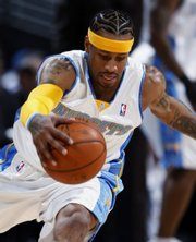 Denver's Allen Iverson reaches out to pull in a loose ball during a Dec. 8 game in Denver against Sacramento.