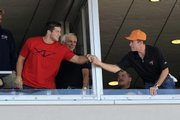 AP Player of the year Tim Tebow, left, shakes hands with a fan at Sunday's Tampa Bay Buccaneers game. Tebow, who also won the Heisman Trophy, was honored by the AP on Tuesday.