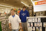 Kansas University men's basketball student manager Justin Pins, left, and freshman Conner Teahan shop for jewelry at Wal-Mart. The Jayhawks shopped for needy families on Thursday.