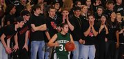 """Free State&squot;s Sarah Craft is taunted by the Lawrence High student section during an inbounds play. The LHS students organized a """"Black Out"""" for Thursday&squot;s games at LHS."""