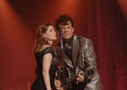 "John C. Reilly, right, and Jenna Fischer star in ""Walk Hard: The Dewey Cox Story,"" a sendup of Hollywood