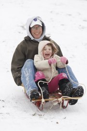 Bruce McEnroe, Lawrence, and his niece, Grace Ladner, 4, from Wichita, bomb down a hill at Centennial Park in this December 2007 file photo.