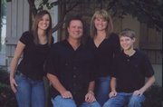 From left are Lauren, Bill, Cindy and Tyler Self. Cindy and Bill met in 1984 in Lawrence, when she was cheering and Bill was playing for the Oklahoma State Cowboys. Oklahoma State lost to Kansas University that night, but the two were later introduced at the Mad Hatter.