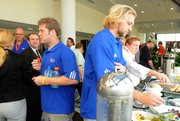 Kansas players Todd Reesing, left, and Kerry Meier hit the buffet table before leaving a news conference at the Hyatt Regency Hotel. KU's offense met the press Monday in Fort Lauderdale, Florida.