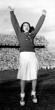 Alberta Mahoney cheers for KU at its game against Georgia Tech in the '48 Orange Bowl. Now Alberta Cornwell, she was president of Student Union Activities.
