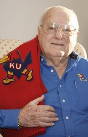 Dick Wintermote was a Kansas University cheerleader during the 1948 Orange Bowl. He displayed his cheerleading sweater Tuesday at his west Lawrence home.