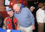Former roommates and teammates on the 1948 Orange Bowl team Marvin Small and Don Fambrough have a laugh at Daisy Duke's restaurant and bar on Wednesday. Members of both the 1948 and 1969 Orange Bowl teams met at the venue for a reunion.