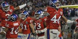 Kansas safety Justin Thornton, right, and the Jayhawks celebrate after an interception returned for a touchdown by cornerback Aqib Talib during the first half of the Orange Bowl Thursday, Jan. 3, 2007 at Dolphin Stadium.
