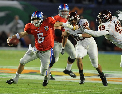 Kansas quarterback Todd Reesing scampers upfield past Virginia Tech defensive end Chris Ellis.