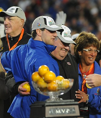 Kansas head coach Mark Mangino hugs his wife Mary Jane and son Tommy following the Jayhawks' victory at the Orange Bowl.