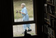 I anticipated this photograph so I could frame Martha Cutter Kelley Smith, 100, with her walking sticks, through the window of Vinland's Coal Creek Library. In fact, I probably waited more than 10 minutes for this brief moment. But with my camera already focused on a spot outside the window and my composition set, all I had to do was press the shutter button as she walked past. Anticipating visual possibilities can put you in the right place at the right time for memorable images.