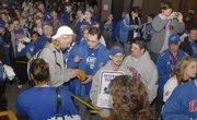 Kansas University's Kerry Meier, left, signs an autograph for Mark Downing, of Topeka, as hundreds of KU fans greet the Jayhawk football team in Topeka as it arrived Friday afternoon fresh from its historic Orange Bowl victory against Virginia Tech.