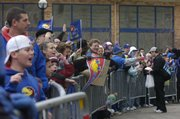 Jayhawk fans welcome back the KU football team Friday, Dec. 4, 2008 as they return from winning the Orange Bowl. More than 150 fans showed up at Allen Fieldhouse to welcome the team.