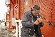 Sherman Tolbert attempts to light a cigarette in a downtown Lawrence alleyway en route to the Lawrence Public Library, 707 Vt. Tolbert is a Lawrence homeless man who has been in and out of jail during his more than 30 years living on the streets. Officials at the Douglas County Jail will soon launch a new program aimed at providing services to offenders after they leave jail to lessen their chances of returning to custody.