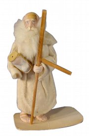 This Father Time is a candy container made of composition material and cloth. He holds his sickle and an hourglass. The 6-3/4-inch figure sold for $77 at a Tom Harris auction in Marshalltown, Iowa.