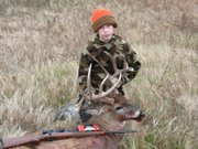 Jacob Ostermeyer, 15, shows off the deer he shot at a park in December. The deer weighed in at more than 200 pounds.