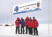 Mark Andresen of Shawnee, far right, and Mike Ketchmark of Leawood, second from right, celebrate with some of the other runners from the Antarctic Ice Marathon.