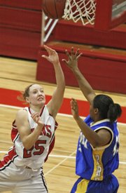 Lawrence High's Haley Parker hits a layup over Lincoln Prep's Jimisha Blanton on Saturday at LHS.