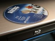 Warner Bros. Entertainment will release high-definition DVDs exclusively in the Blu-ray disc format, the company said Friday, becoming the latest studio to favor Blu-ray over the rival HD DVD technology.