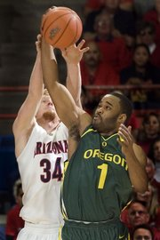 Oregon's Malik Hairston (1) battles for a rebound with Arizona's Chase Budinger (34). The Ducks upended the Wildcats, 84-74, in the Pac-10 opener for both teams Saturday in Tucson, Ariz.