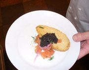 A citrus salmon appetizer topped with caviar was designed for United Airlines flight attendants to assemble easily at 30,000 feet.