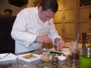 World-renowned chef Charlie Trotter, who recently joined forces with United Airlines, works on potential high-flying appetizers in his test kitchen. Major airlines are upgrading their premium menu offerings, a sign of the industry's economic revival and increasing focus on overseas expansion.