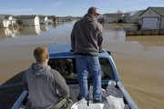 Residents of Fernley, Nev., distribute sand bags Saturday after a levee break caused flooding, pouring more than 3 feet of near-freezing water into hundreds of homes and stranding 3,500 people across a square mile.