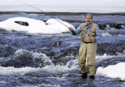 "Fly fisherman Lou Ureneck, the author of ""Backcast,"" fishes in the Royal River in Yarmouth, Maine. Ureneck wrote the book about a trip he and teenage son Adam took through the Alaskan wilderness."