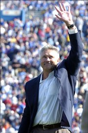 Former Kansas University quarterback Nolan Cromwell salutes the crowd at Memorial Stadium after being inducted into the KU Ring of Honor. Cromwell, receivers coach for the Seattle Seahawks, was named offensive coordinator at Texas A&M on Saturday.