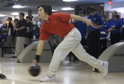 LHS senior Jerry Wang warms up Saturday during the Free State High School bowling tournament at Royal Crest Lanes.