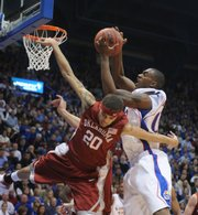 Kansas forward Darrell Arthur rips away a rebound from Oklahoma guard Austin Johnson during the first half Monday, Jan. 14, 2008 at Allen Fieldhouse.