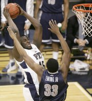 Pittsburgh's DeJuan Blair, left, goes to the basket against Georgetown's Patrick Ewing, Jr. The No. 15 Panthers upended the No. 5 Hoyas, 69-60, Monday in Pittsburgh.