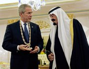 Saudi King Abdullah, right, examines the King Abdul Aziz Order of Merit on President Bush, left, with after bestowing it upon him following their dinner at Riyadh Palace on Monday.