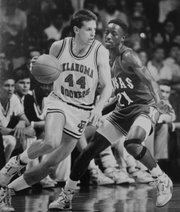 Oklahoma's Dave Sieger attempts to drive around KU's Milt Newton during the NCAA title game on April 4, 1988 in Kansas City, Mo. Sieger, known as the Sooners' top sharpshooter, scored 22 points in the 83-79 loss, including seven three-pointers.