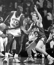 Mookie Blaylock, left, looks to make a pass against Scooter Barry during the Jayhawks' 83-79 win over the Sooners on April 4, 1988, to secure the school's fourth national championship.