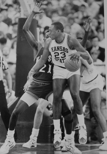 Mitch Richmond backs in against Milt Newton during the 1987-88 season.