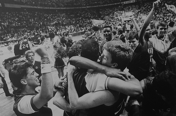 Sophomore guard Jeff Gueldner, right, embraces a teammate following KU's NCAA Championship game victory over Oklahoma, 83-79, in Kansas City's Kemper Arena.