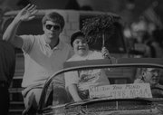 Ryan Gray celebrates during the 1988 parade for the Kansas University championship basketball team. At left is John Robic, who is currently an assistant coach for John Calipari at Memphis.