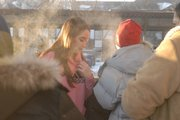 Residents huddle together outside in 2 degree temperatures after their leaving their apartment building, which caught fire about 6 a.m. Saturday. Lawrence-Douglas County Fire & Medical responded to the fire. Investigators have not determined the cause of the fire, but witnesses say it began when a mattress came in contact with a burning candle.
