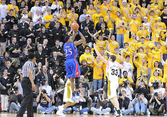 Kansas guard Brandon Rush elevates for a jumper before Missouri forward Matt Lawrence and the Mizzou student section during the second half Saturday, Jan. 19, 2008 at Mizzou Arena in Columbia, Missouri.