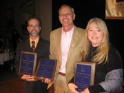 Award winners during Friday's Lawrence Board of Realtors Installation Mixer are, from left, Tom Harper, Salesperson of the Year; Gary Nuzum, Distinguished Service Award; and Deborah McMullen, Realtor of the Year.