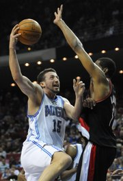 Orlando's Hedo Turkoglu, left, goes up for a shot against Portland's LaMarcus Aldridge. The Magic won, 101-94, on Saturday night in Orlando, Fla.