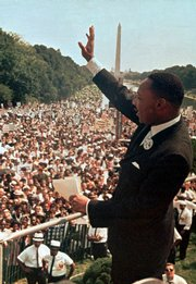 "The Rev. Martin Luther King Jr. acknowledges the crowd at the Lincoln Memorial for his ""I Have a Dream"" speech during the March on Washington, D.C., on Aug. 28, 1963. The march was organized to support proposed civil rights legislation and end segregation. King was awarded the Nobel Peace Prize in 1964 and was assassinated in Memphis, Tenn., in April 1968."
