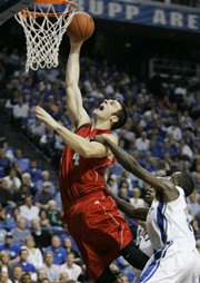 Louisville's David Padgett, left, tries to shoot as Kentucky's Ramel Bradley fouls him. Louisville dominated UK, 89-75, on Jan. 5. It was Padgett's second game back after a fractured knee cap that, doctors said, likely would end his career.